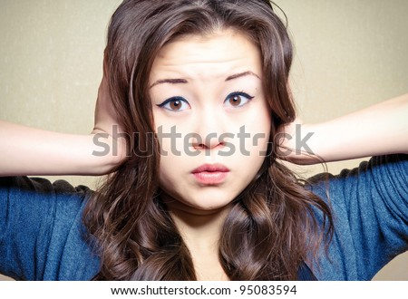 Cute girl pressing her head confused and surprised - stock photo