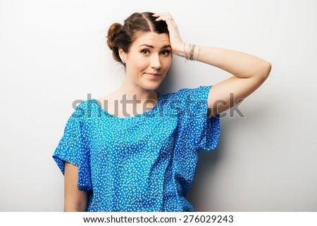Cute  girl remembered something and holding his head - stock photo