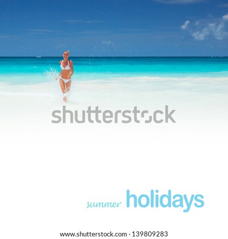 Cute girl runs out of the sea with water splash, beautiful clean beach, luxury resort in the Mexico, summer holidays concept - stock photo