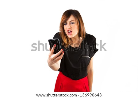 Cute girl shouting at her mobile phone. Problems with customer support. - stock photo