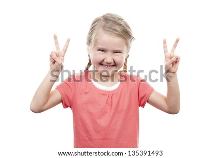 cute girl showing victory sign on white background - stock photo
