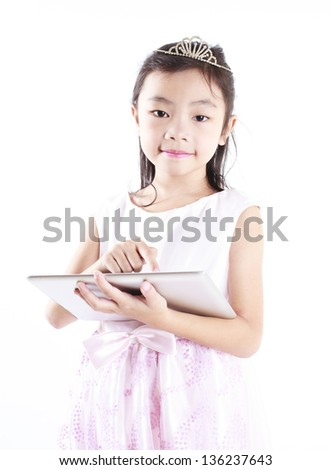 Cute girl use a tablet for studying - stock photo