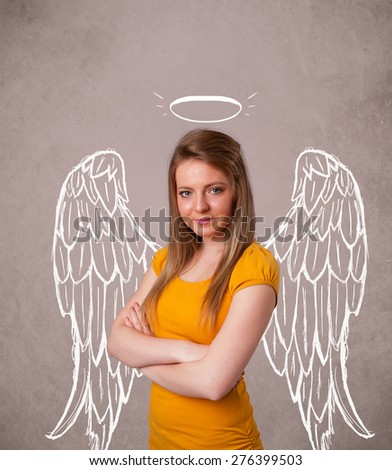 Cute girl with angel illustrated wings on grungy background - stock photo