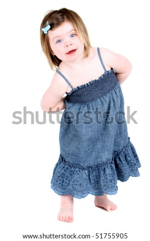 Cute girl with arms folded behind her back - stock photo
