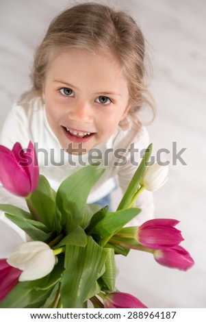 Cute girl with bouquet of tulips top view  - stock photo