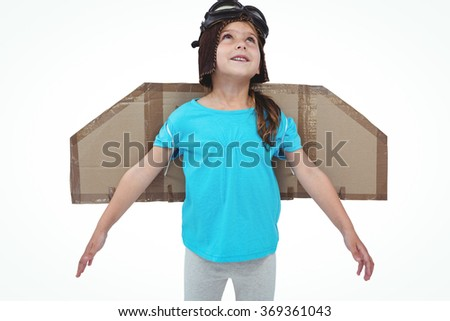 Cute girl with fake wings pretending to be pilot on white screen - stock photo