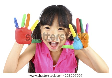 Cute girl with hands in the paint  - stock photo