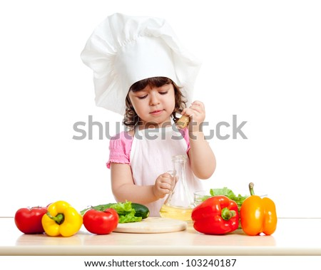 cute girl with healthy food vegetables and sunflower oil - stock photo