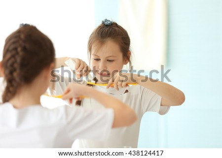 Cute girl with toothbrush - stock photo