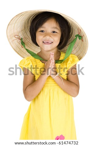 cute girl with vietnamese hat and typical asian welcome expression, isolated on white background - stock photo
