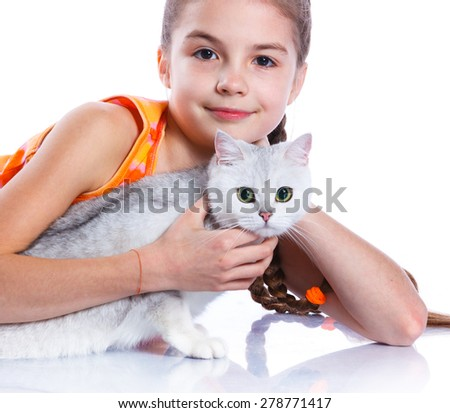 Cute girl with white cat smiling at camera on isolated white background. Focus of the cat - stock photo