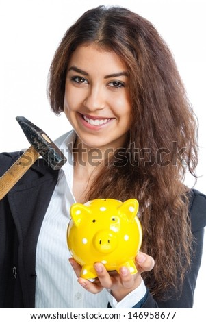 Cute girl with yellow piggy bank and hammer on white background - stock photo