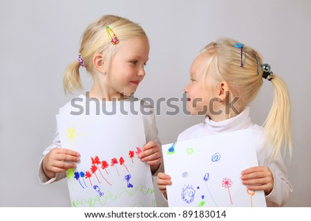 cute girls show their pictures - stock photo