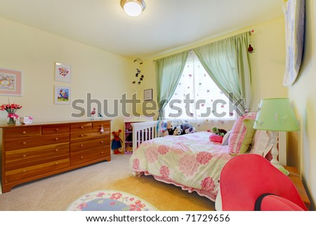 Cute green bedroom with flower bedding - stock photo