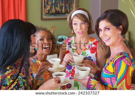 Cute group of retro style women drinking tea - stock photo