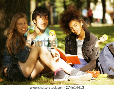 cute group of teenages at the building of university with books huggings, diversity nations, having lunch - stock photo