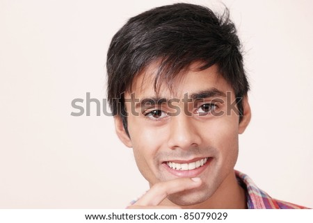 Cute guy grinning - stock photo