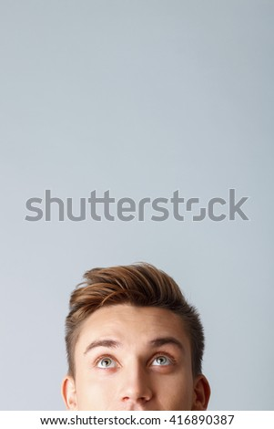 Cute guy is evincing his curiosity - stock photo