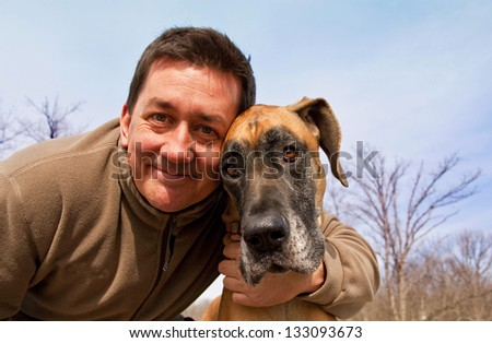 Cute guy with his dog - stock photo