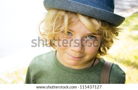 cute happy boy child outside smiling - stock photo