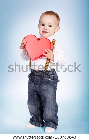 cute happy boy holds heart in hands - stock photo