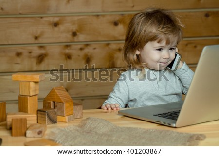 Cute happy  child boy talking on mobile phone - stock photo