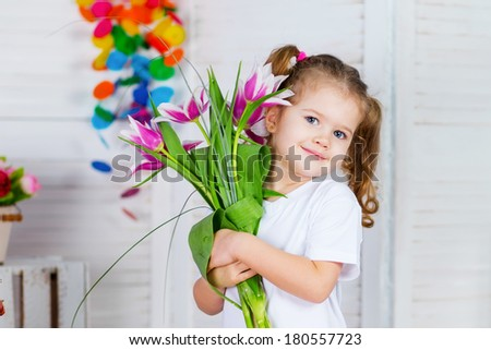 Cute happy girl posing at spring flowers background  - stock photo