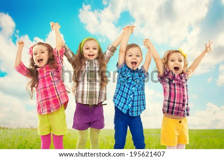 Cute happy kids are jumping together. Happiness, fashionable and friendship concept - stock photo