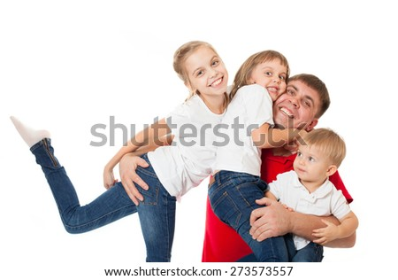 Cute happy smiling family of two sisters daughters with father and junior brother posing on white background - stock photo