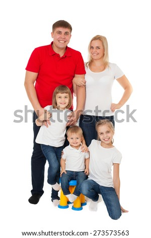 Cute happy smiling family of two sisters daughters with parents and junior brother posing on white background - stock photo