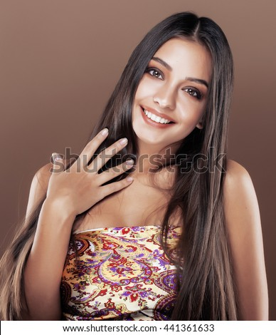 cute happy young indian woman in studio close up smiling, fashio - stock photo