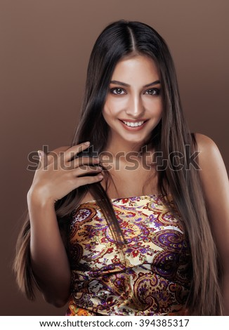 cute happy young indian woman in studio close up smiling, fashion mulatto beauty - stock photo