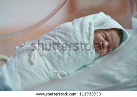 cute healthy new born baby portrait in hospital - stock photo