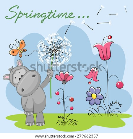 Cute Hippo with dandelion on a meadow  - stock photo