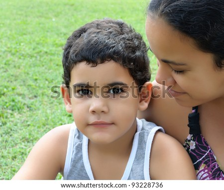 Cute hispanic boy and his beautiful young mother - stock photo