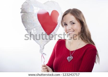Cute hispanic girl just got a balloon for valentine's - stock photo