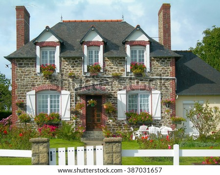 Cute house with garden in Normandy France - stock photo