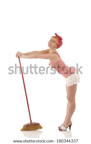 Cute housewife with broom - stock photo