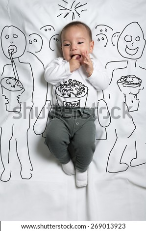 Cute infant baby boy sketched in the cinema - stock photo