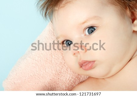 cute infant smiling, beautiful kid's face closeup with copyspace - stock photo