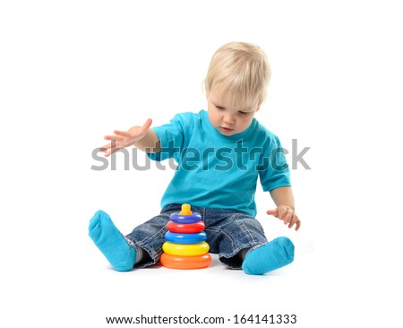 Cute kid girl playing with educational toy isolated on white background - stock photo