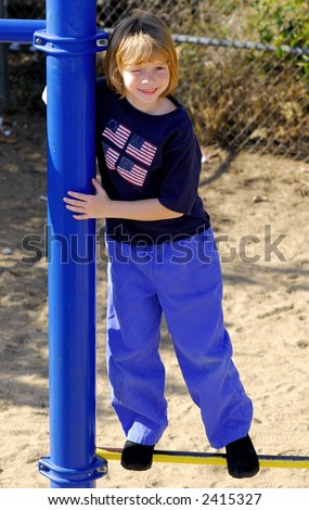 Cute kid in a playground - stock photo