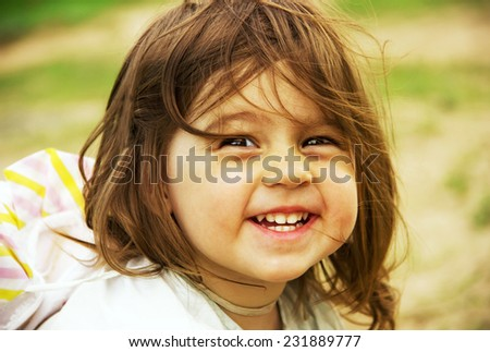Cute kid playing on send in summer day - stock photo