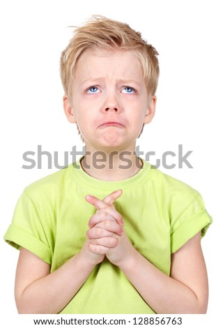 Cute kid putting his hands together as if begging for something - stock photo