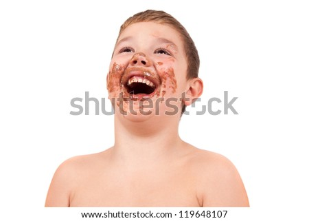 Cute kid with chocolate on his face - stock photo