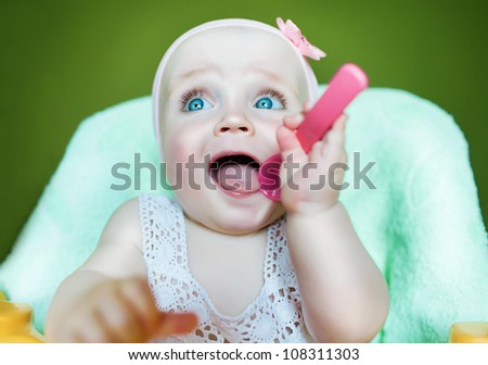cute kid with pink spoon - stock photo