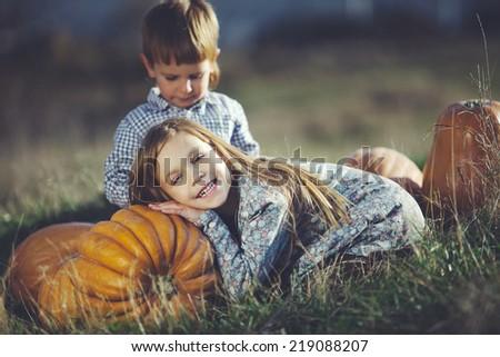 Cute kids having fun at countryside at halloween - stock photo