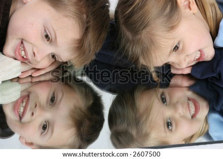 cute kids in mirror - stock photo