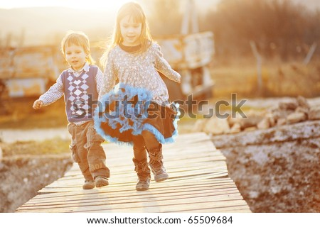 Cute kids resting at countryside - stock photo