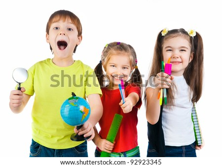 Cute kids with notebook and globe on white background - stock photo